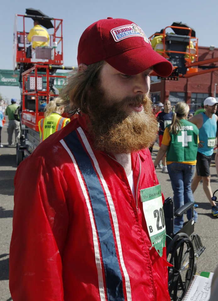 Omaha, Neb., resident Jeff Ellwanger dressed as Forrest Gump while running the Oklahoma City Memorial Marathon in Oklahoma City, Sunday, April 28, 2013, By Paul Hellstern, The Oklahoman