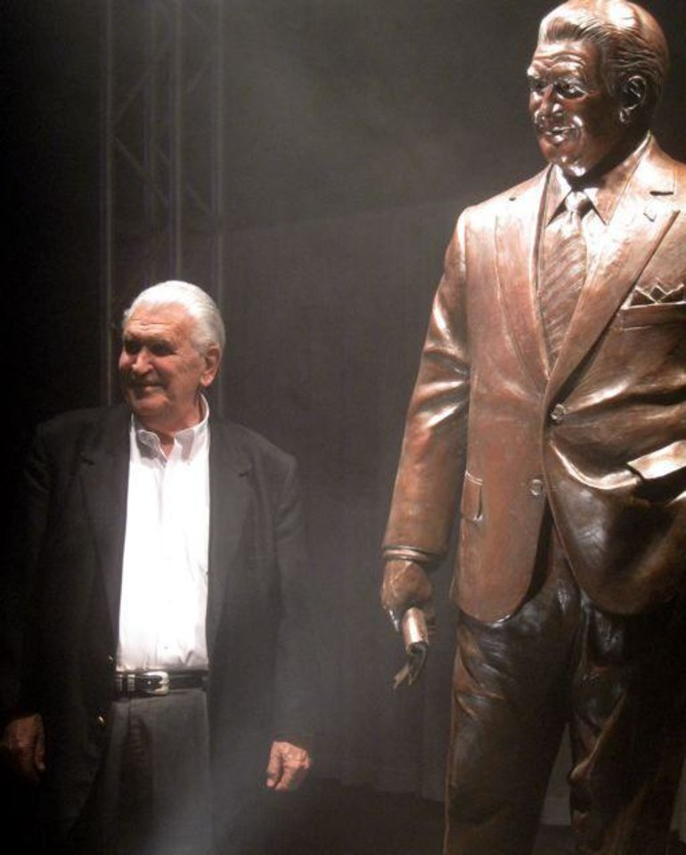 LEE ALLAN SMITH DAY....Lee Allan Smith and his statue. (Photo by Helen Ford Wallace).