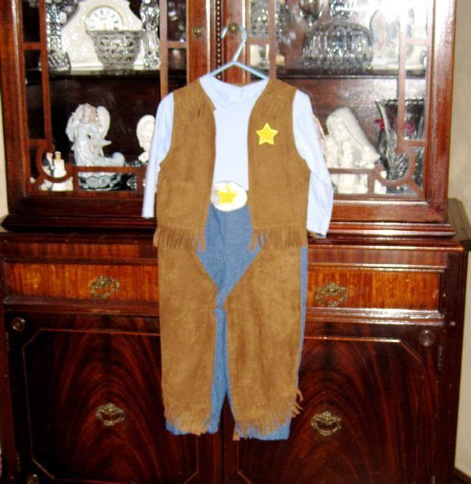 HE\'S A BOY....An outfit for the little boy. He will be born in January and will have three sisters. (Photo by Helen Ford Wallace).
