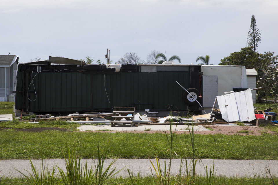 Photo - A trailer lies flipped on the ground in the aftermath of Hurricane Irma at Citrus Park in Bonita Springs, Fla., on Wednesday, Sept. 13, 2017. (Nicole Raucheisen/Naples Daily News via AP)