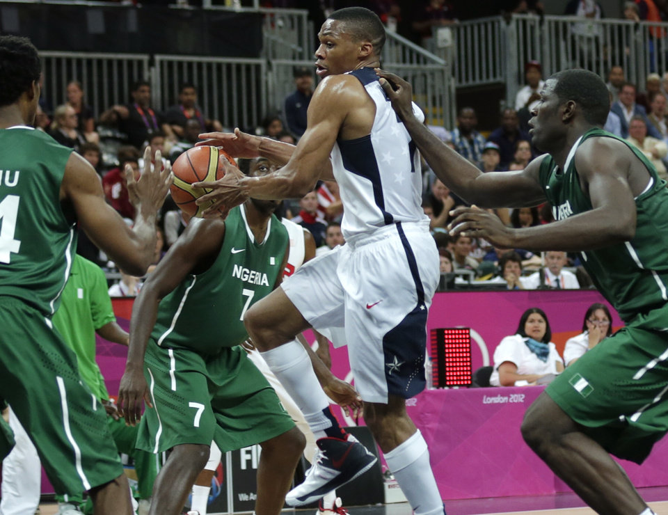 Photo -   USA's Russell Westbrook threads to the basket against Nigeria during a men's basketball game at the 2012 Summer Olympics, Thursday, Aug. 2, 2012, in London. (AP Photo/Charles Krupa)