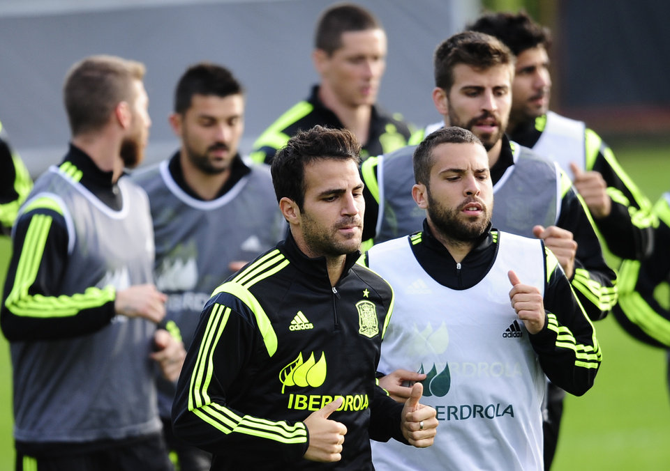 Photo - Spain's Cesc Fabregas, left center, and Jordi Alba, right center, run with their teammates during a training session at the Atletico Paranaense training center in Curitiba, Brazil, Monday, June 9, 2014. Spain will play in group B of the Brazil 2014 World Cup. (AP Photo/Manu Fernandez)
