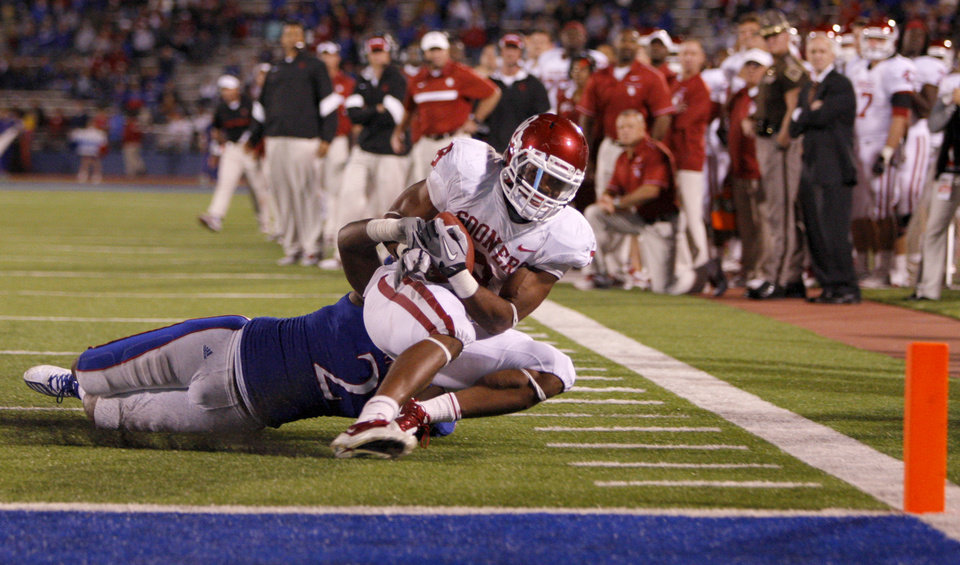 Photo - Oklahoma's Dominique Whaley (8) is brought down short of the goal by Kansas' Darius Willis (2) during the college football game between the University of Oklahoma Sooners (OU) and the University of Kansas Jayhawks (KU) at Memorial Stadium in Lawrence, Kansas, Saturday, Oct. 15, 2011. Photo by Bryan Terry, The Oklahoman