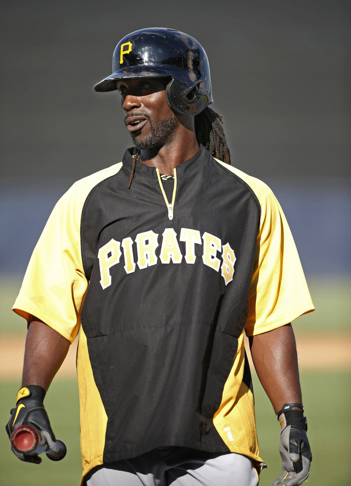 Photo - Pittsburgh Pirates' Andrew McCutchen carries his bat to the batting cage before the Pirates' spring exhibition baseball game against the New York Yankees in Tampa, Fla., Friday, March 21, 2014. (AP Photo/Kathy Willens)