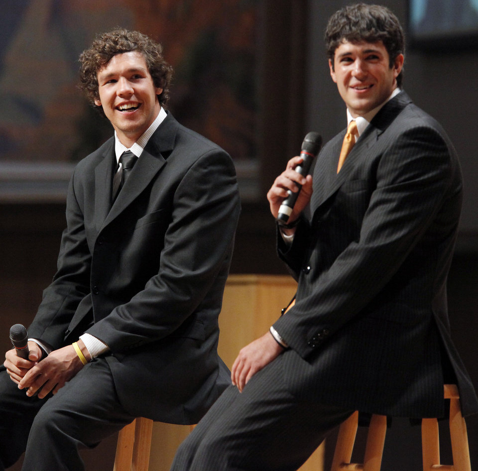 Photo - OKLAHOMA STATE UNIVERSITY / UNIVERSITY OF OKLAHOMA / COLLEGE FOOTBALL PLAYERS / FCA BANQUET: OU quarterback Sam Bradford, left, and OSU quarterback Zac Robinson answer questions during the Fellowship of Christian Athletes All-State Banquet at the National Cowboy & Western Heritage Museum in Oklahoma City, Monday, April 27, 2009. Robinson and Bradford were special guests at the event. Photo by Nate Billings, The Oklahoman ORG XMIT: KOD