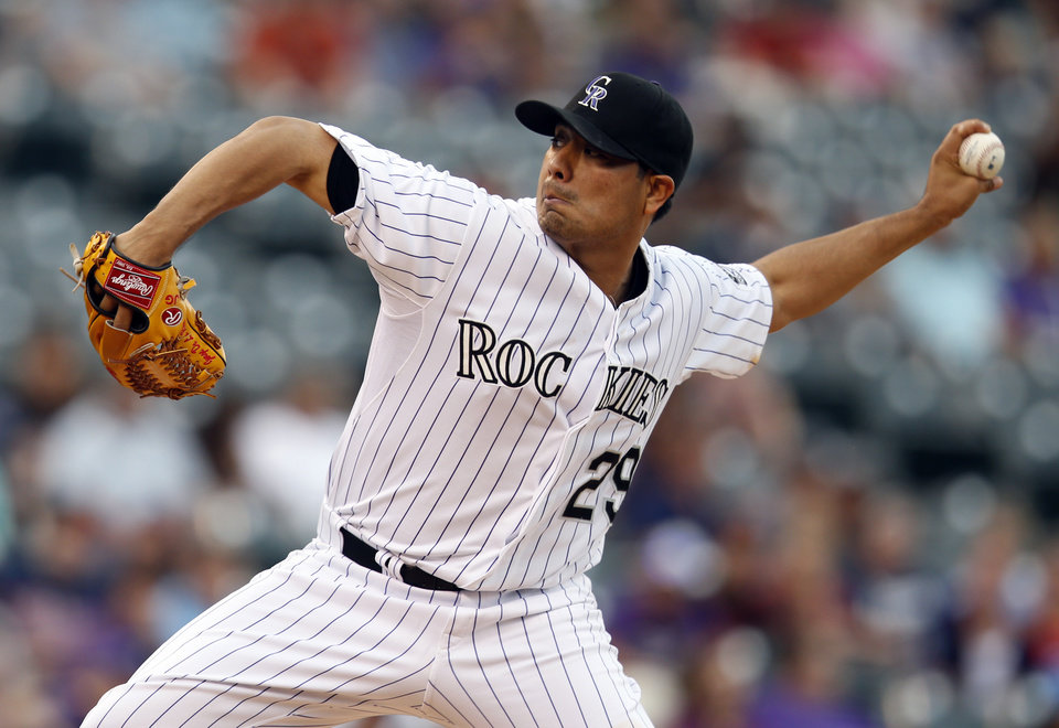 Photo - Colorado Rockies starting pitcher Jorge De La Rosa throws to the plate against the Minnesota Twins during the first inning of a baseball game on Friday, July 11, 2014, in Denver. (AP Photo/Jack Dempsey)