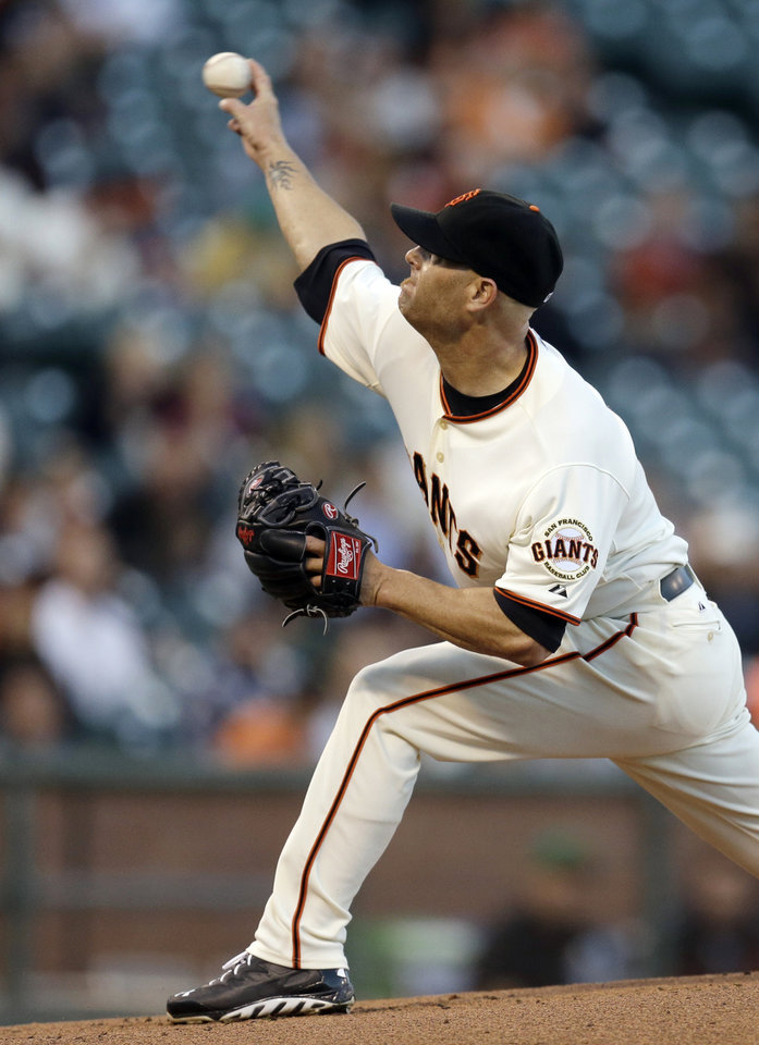 Photo - San Francisco Giants' Tim Hudson pitches to the Colorado Rockies in the first inning of a baseball game Wednesday, Aug. 27, 2014, in San Francisco. (AP Photo/Ben Margot)