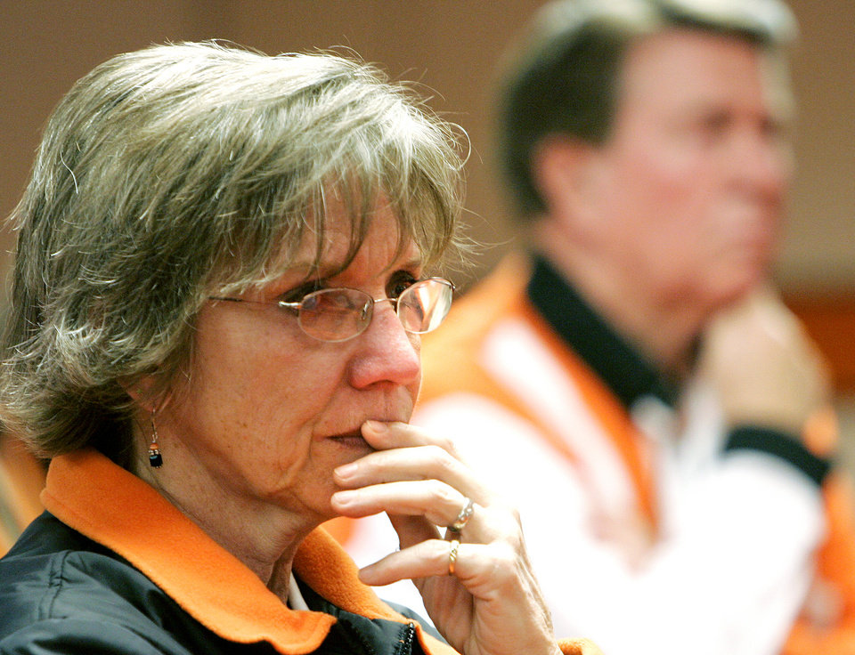 Photo - Marilyn Middlebrook (left) listens to a press conference involving Oklahoma State University (OSU) college basketball head coach Eddie Sutton at Gallagher-Iba Arena in Stillwater, Wednesday, Feb. 15, 2006. Middlebrook, the associate athletic director and team counselor, said she has known Sutton for 16 years. by John Clanton/The Oklahoman.