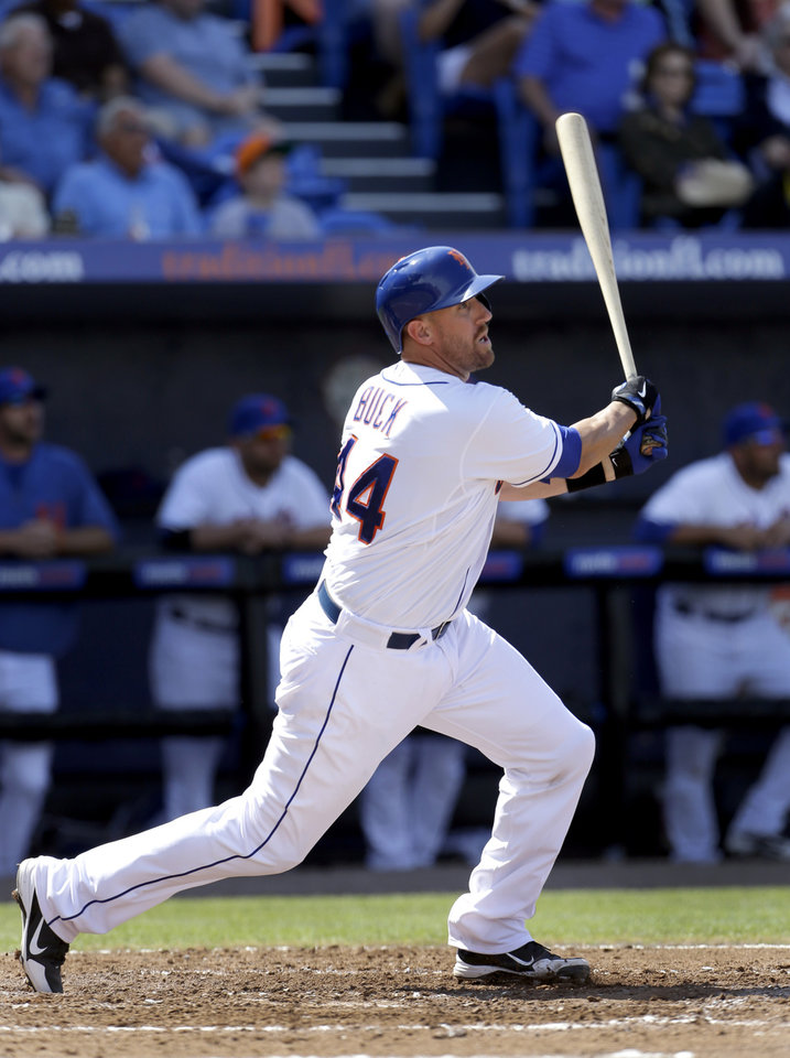 New York Mets' John Buck hits a ground-rule double to score Lucas Duda during the third inning of an exhibition spring training baseball game against the Houston Astros Saturday, March 9, 2013, in Port St. Lucie, Fla. (AP Photo/Jeff Roberson)