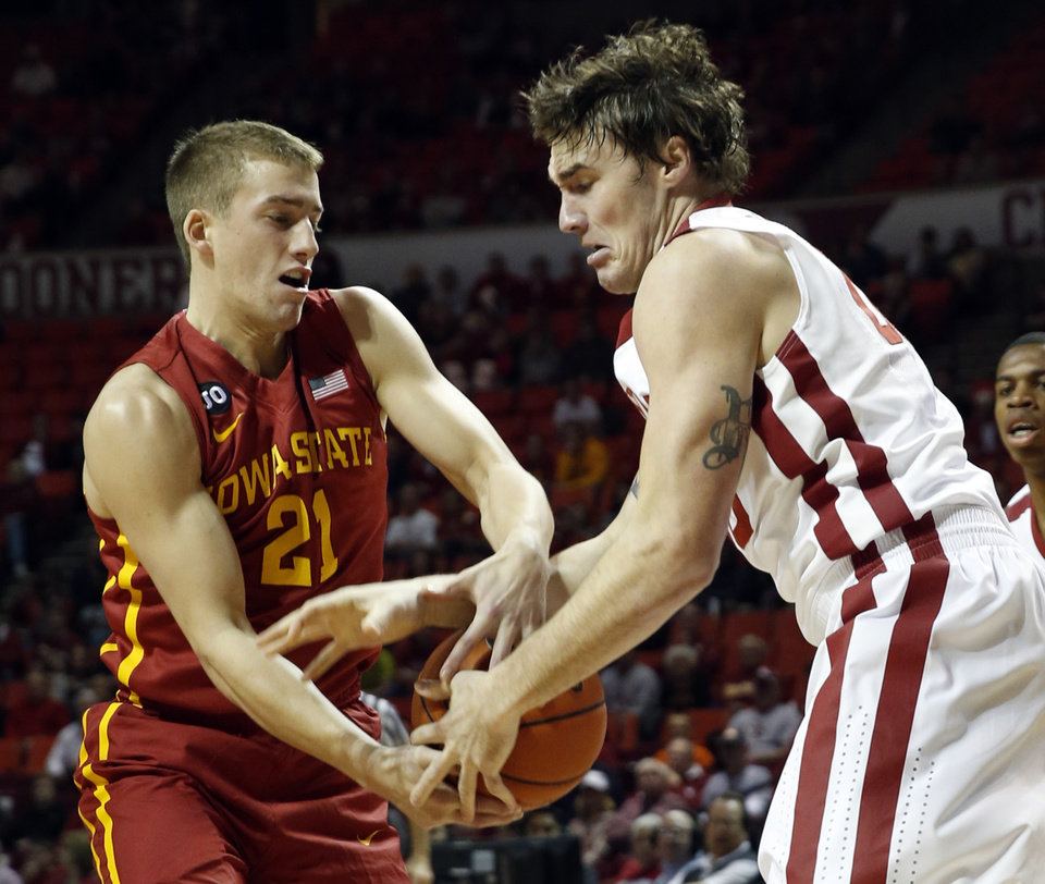 Photo - Matt Thomas (21) and Ryan Spangler fight for a rebound as the University of Oklahoma Sooners (OU) men play the Iowa State Cyclones (ISU) in NCAA, college basketball at The Lloyd Noble Center on Saturday, Jan. 11, 2014  in Norman, Okla. Photo by Steve Sisney, The Oklahoman