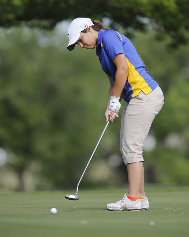 Photo - Mikera Morris of Dibble High School sinks a putt on a green on the back nine during the 2014 Class 2A girls' golf state championship tournament  Wednesday, May 7, 2014, at Trosper Golf Course in Del City.  Photo by Jim Beckel, The Oklahoman
