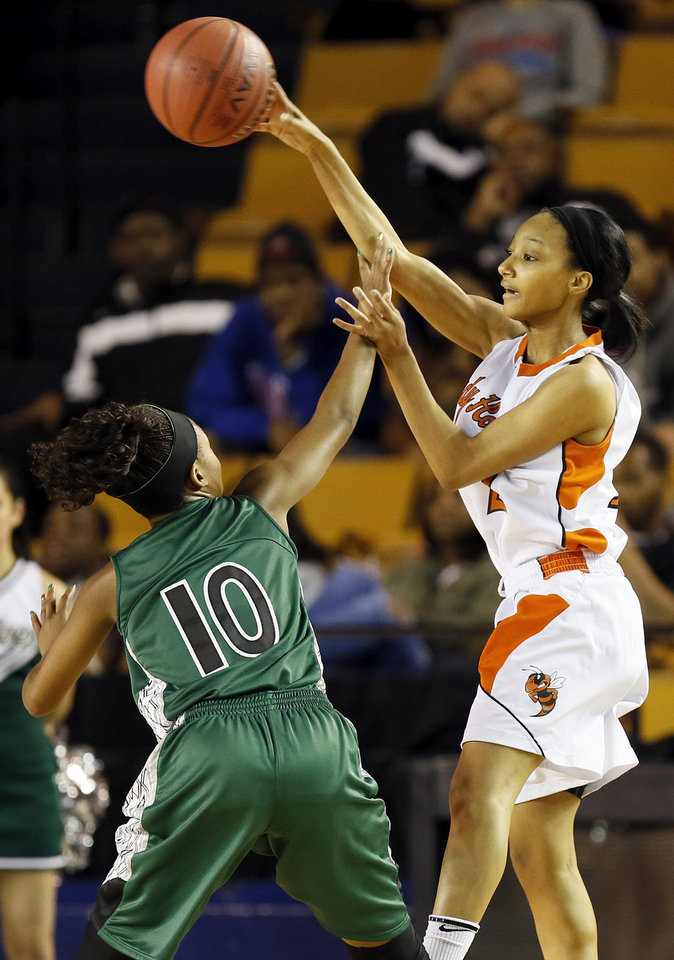 Booker T. Washington's Kaylan Mayberry (12) passes over Edmond Santa Fe's Cameraah Graves (10) during a Class 6A girls high school basketball game in the semifinals of the state tournament at the Mabee Center in Tulsa, Okla., Friday, March 8, 2013. Photo by Nate Billings, The Oklahoman