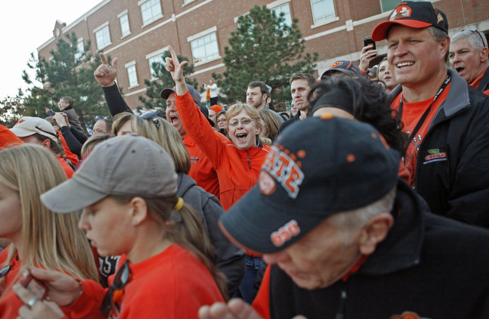 Photo - Fans cheer during the Spirit Walk before the Bedlam college football game between the University of Oklahoma Sooners (OU) and the Oklahoma State University Cowboys (OSU) at Boone Pickens Stadium in Stillwater, Okla., Saturday, Nov. 27, 2010. Photo by Bryan Terry, The Oklahoman
