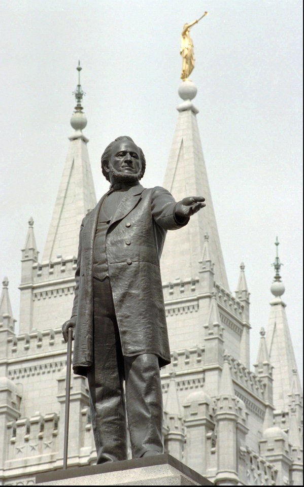 Photo -   FILE - In this April 1, 1998 file photo, a statue of Mormon pioneer leader Brigham Young stands in front of The Church of Jesus Christ of Latter-day Saints' Temple in Salt Lake City. Latter-day Saints are anxious about what's ahead. Republican Mitt Romney is about to become the first Mormon nominee for U.S. president on a major party ticket, giving Mormons a chance like no other to explain their tradition to the public. But the church's many critics will have a bigger platform, too. And the vetting will take place amid the emotion of what observers expect will be a nasty general election. (AP Photo/Douglas C. Pizac, File)