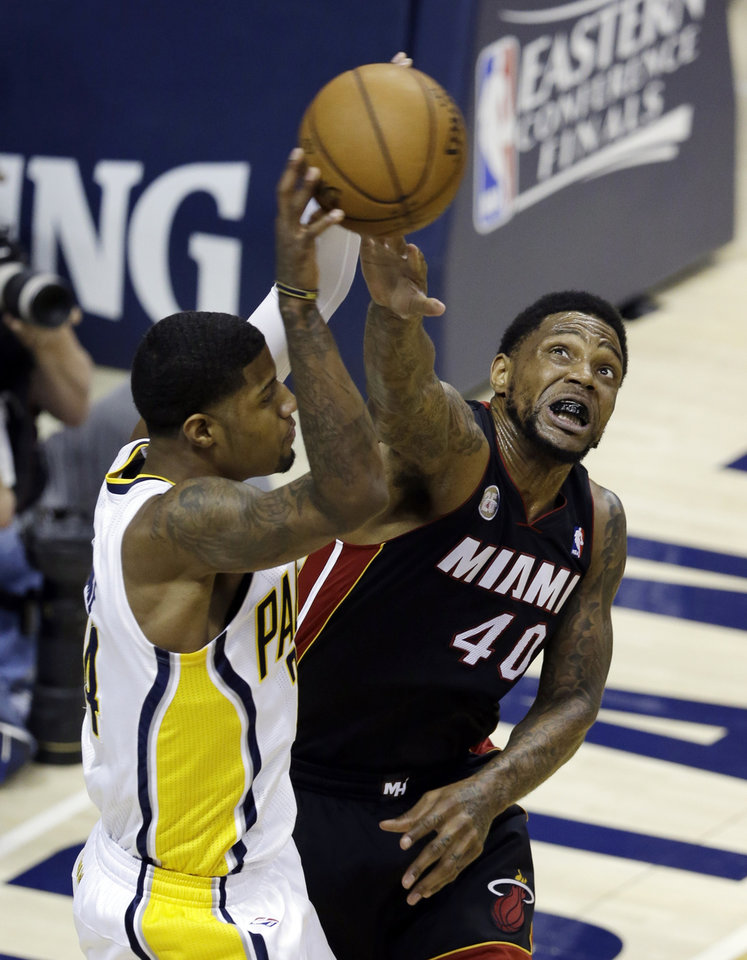 Indiana Pacers' Paul George (24) makes a pass against Miami Heat's Udonis Haslem during the first half of Game 3 of the NBA Eastern Conference basketball finals in Indianapolis, Sunday, May 26, 2013. (AP Photo/Michael Conroy)