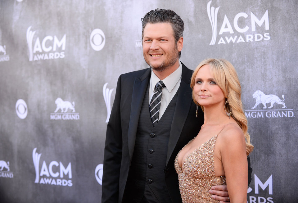 Photo - Blake Shelton, left, and Miranda Lambert arrive at the 49th annual Academy of Country Music Awards at the MGM Grand Garden Arena on Sunday, April 6, 2014, in Las Vegas. (Photo by Al Powers/Powers Imagery/Invision/AP)