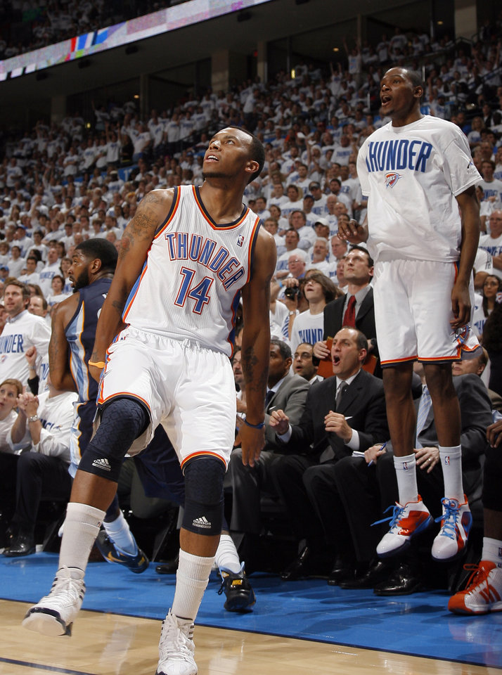 Oklahoma City's Kevin Durant (35) celebrates a 3-pointer by Daequan Cook (14) during game five of the Western Conference semifinals between the Memphis Grizzlies and the Oklahoma City Thunder in the NBA basketball playoffs at Oklahoma City Arena in Oklahoma City, Wednesday, May 11, 2011. Photo by Sarah Phipps, The Oklahoman