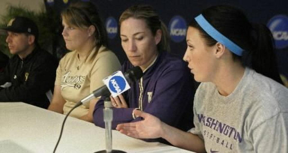 Washington's Danielle Lawrie, right, answers a question during a news conference for the NCAA  softball championships in Oklahoma City, Wednesday, May 27, 2009. From left are Missouri coach Ehren Earleywine, Missouri's Chelsea Thomas,  Washington coach Heather Tarr and Lawrie. Tournament play begins Thursday. (AP Photo)