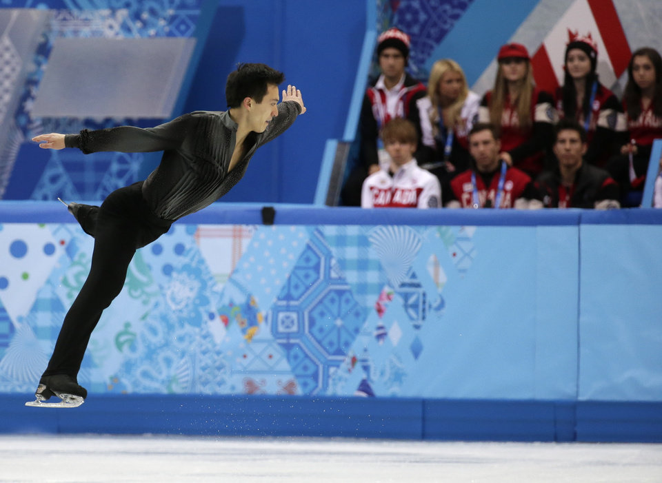 Photo - Patrick Chan of Canada competes in the men's team short program figure skating competition at the Iceberg Skating Palace during the 2014 Winter Olympics, Thursday, Feb. 6, 2014, in Sochi, Russia. (AP Photo/Bernat Armangue)