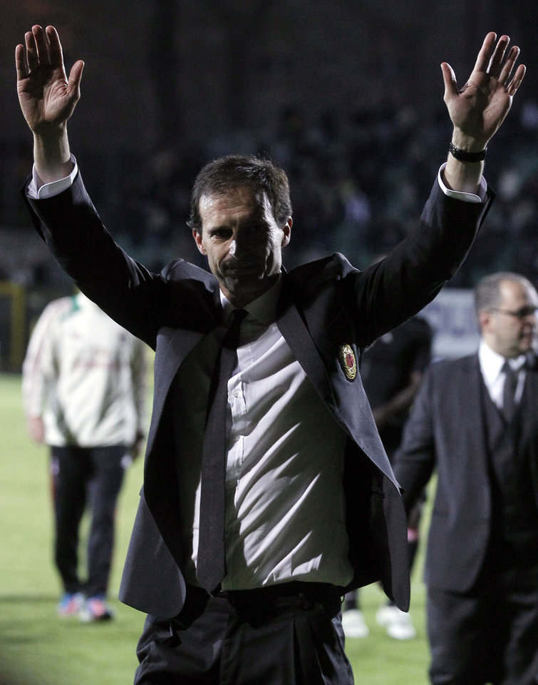 Photo - AC Milan coach Massimiliano Allegri waves to fans at the end of a Serie A soccer match between Siena and AC Milan, in Siena, Italy, Sunday, May 19, 2013. (AP Photo/Paolo Lazzeroni)