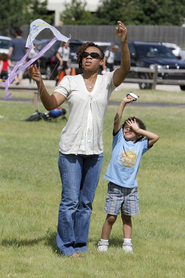 Achese Taylor helps her four year old son Israel get his kite airborne during LibertyFest\'s kite festival at Mitch Park in Edmond, OK, Saturday, June 29, 2013, Photo by Paul Hellstern, The Oklahoman