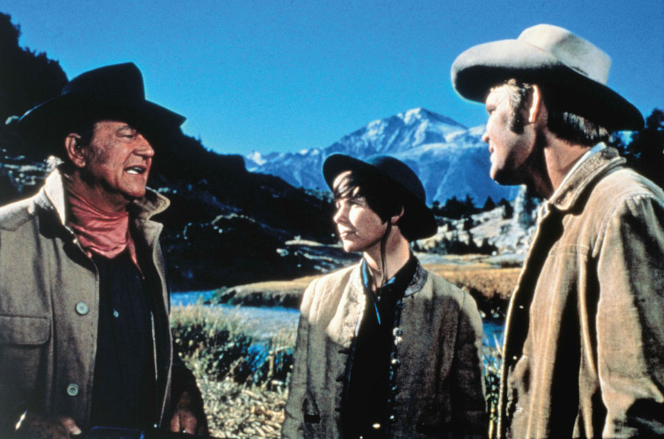 "Photo - In this 1969 publicity image released by Paramount Home Entertainment, John Wayne, left, Kim darby, center, and Glen Campbell are shown in a scene from, ""True Grit."" (AP Photo/Paramount Home Video) ORG XMIT: NYET896"