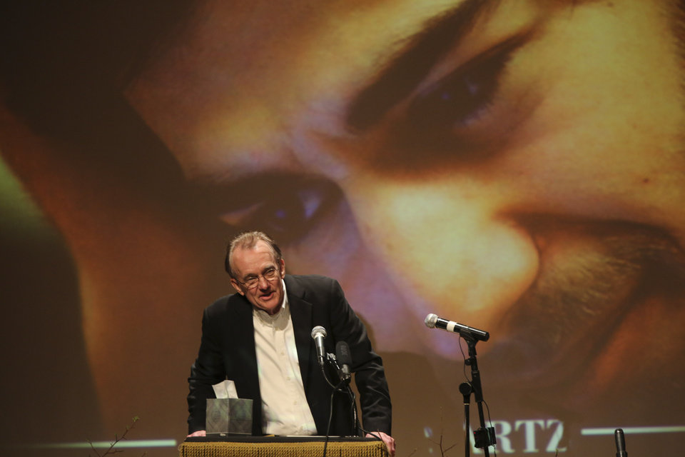 Photo - Edward Tufte, professor emeritus of political science, statistics, and computer science at Yale University speaks during the memorial service for Aaron Swartz, Saturday, Jan. 19, 2013 in New York. Friends and supporters of Aaron Swartz paid tribute Saturday to the free-information activist and online prodigy, who killed himself last week as he faced trial on hacking charges. (AP Photo/Mary Altaffer)