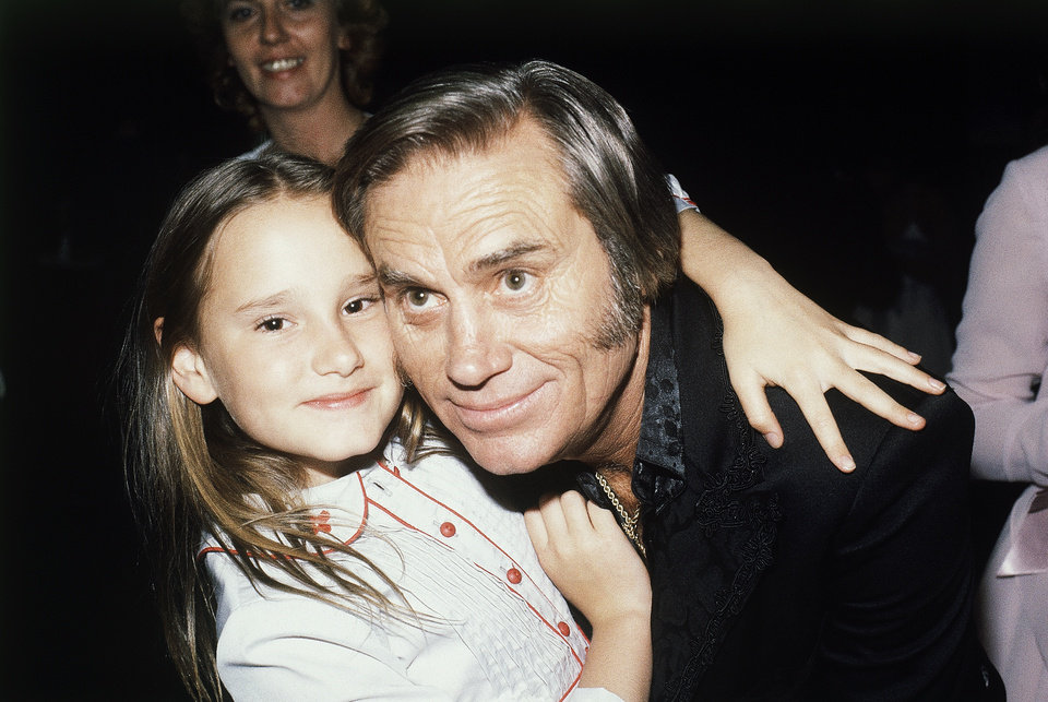 Photo - FILE - In this April 30, 1981 file photo, Country singer George Jones, winner of top male vocalist award at the Academy of Country Music Awards, poses with his daughter Georgette, in Los Angeles, Calif.   Jones, the peerless, hard-living country singer who recorded dozens of hits about good times and regrets and peaked with the heartbreaking classic