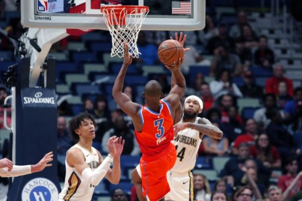 Photo -  Oklahoma City Thunder guard Chris Paul goes up for a basket during the second half of Sunday's game at New Orleans. Paul scored seven points on a 12-0 run as OKC beat the Pelicans, 107-104. [AP Photo/Gerald Herbert]