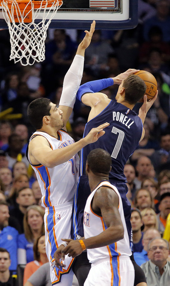 Photo - Oklahoma City's Enes Kanter (11) defends on Dallas' Dwight Powell (7) during the NBA basketball game between the Oklahoma City Thunder and the Dallas Mavericks at Chesapeake Energy Arena on Wednesday, Jan. 13, 2016, in Oklahoma City, Okla.  Photo by Chris Landsberger, The Oklahoman