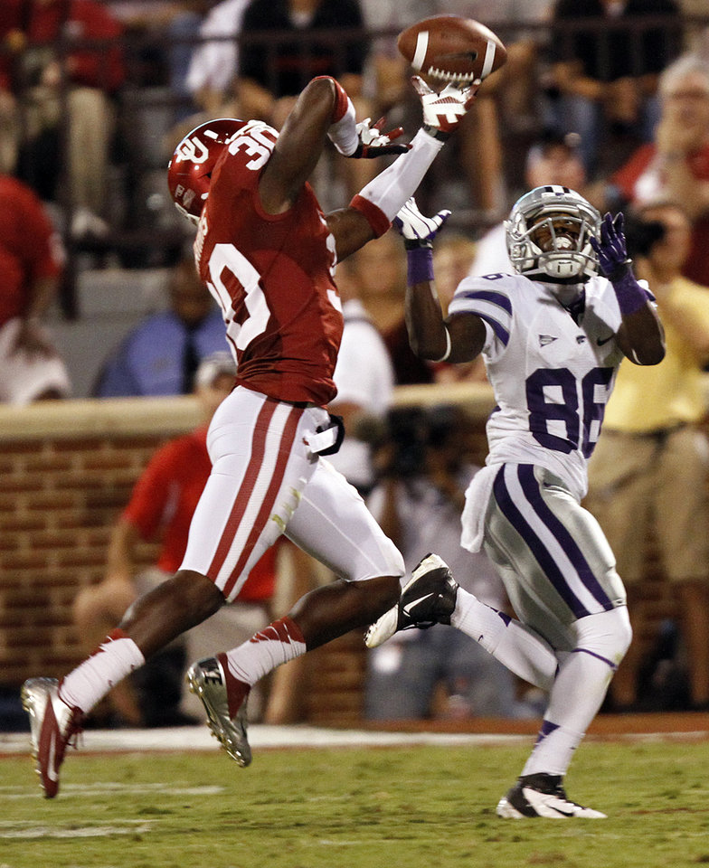 Photo - Oklahoma's Javon Harris (30) breaks up a pass for Kansas State's Tramaine Thompson (86) during the college football game between the University of Oklahoma Sooners (OU) and the Kansas State University Wildcats (KSU) at the Gaylord Family-Memorial Stadium on Saturday, Sept. 22, 2012, in Norman, Okla. Photo by Chris Landsberger, The Oklahoman