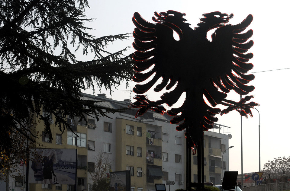 Photo -   An installation of a two headed black eagle, the symbol of Albania, is placed near a street in Macedonia's capital Skopje, on Saturday, Nov.24, 2012. Macedonian capital Skopje, particularly the parts populated with ethnic Albanians, are flooded with Albanian flags, in the eve of the celebration of 100 years of Albania's independence and the national flag. Ethnic Albanians make up a quarter of Macedonia's 2.1 million people and are the largest ethnic minority in the country. (AP Photo/Boris Grdanoski)