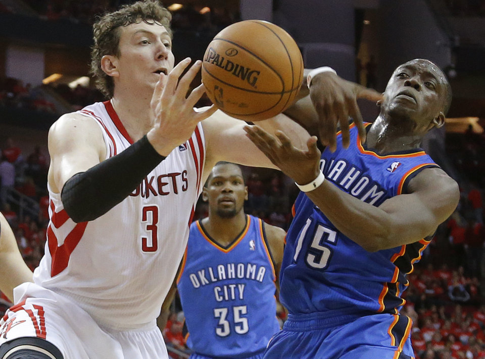 Photo - Oklahoma City's Reggie Jackson (15) fights for the ball with Houston's Omer Asik (3) during Game 6 in the first round of the NBA playoffs between the Oklahoma City Thunder and the Houston Rockets at the Toyota Center in Houston, Texas, Friday, May 3, 2013. Oklahoma City won 103-94. Photo by Bryan Terry, The Oklahoman