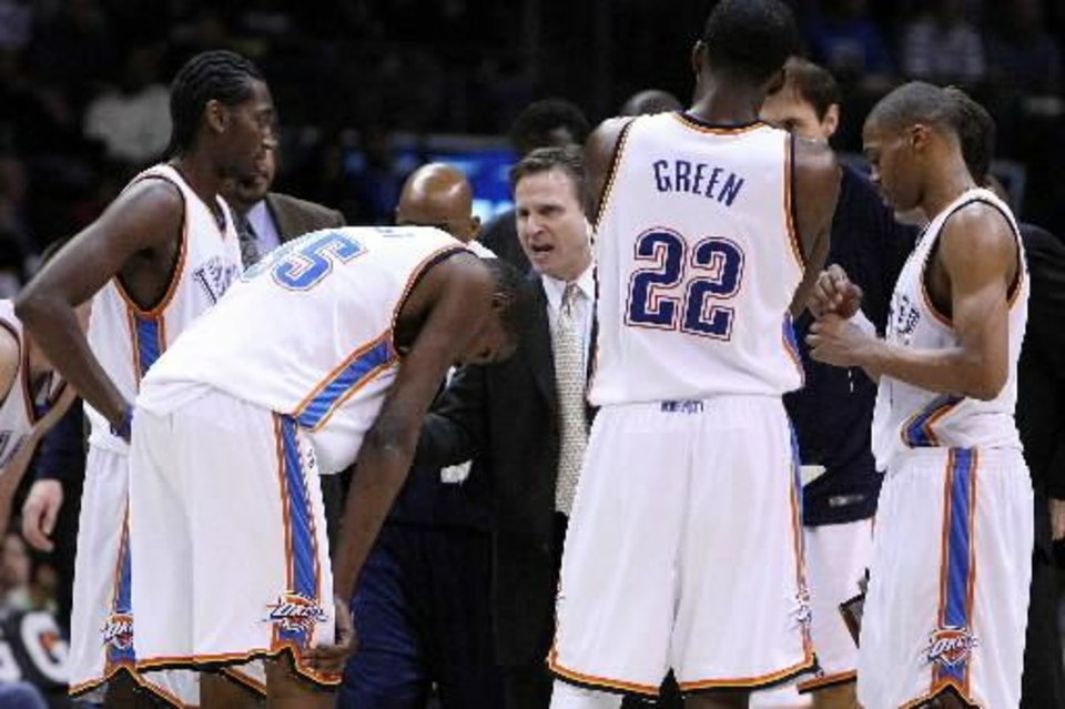 Oklahoma City Thunder head coach  Scott  Brooks talks to his team during the Thunder - Sacramento game February 8, 2009 in the Ford Center in Oklahoma City. BY HUGH  SCOTT
