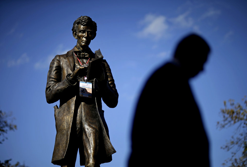 Photo -   A personalized Abraham Lincoln credential for Thursday's vice presidential debate hangs on a statue of Lincoln, Wednesday, Oct. 10, 2012, at Centre College in Danville, Ky. (AP Photo/David Goldman)