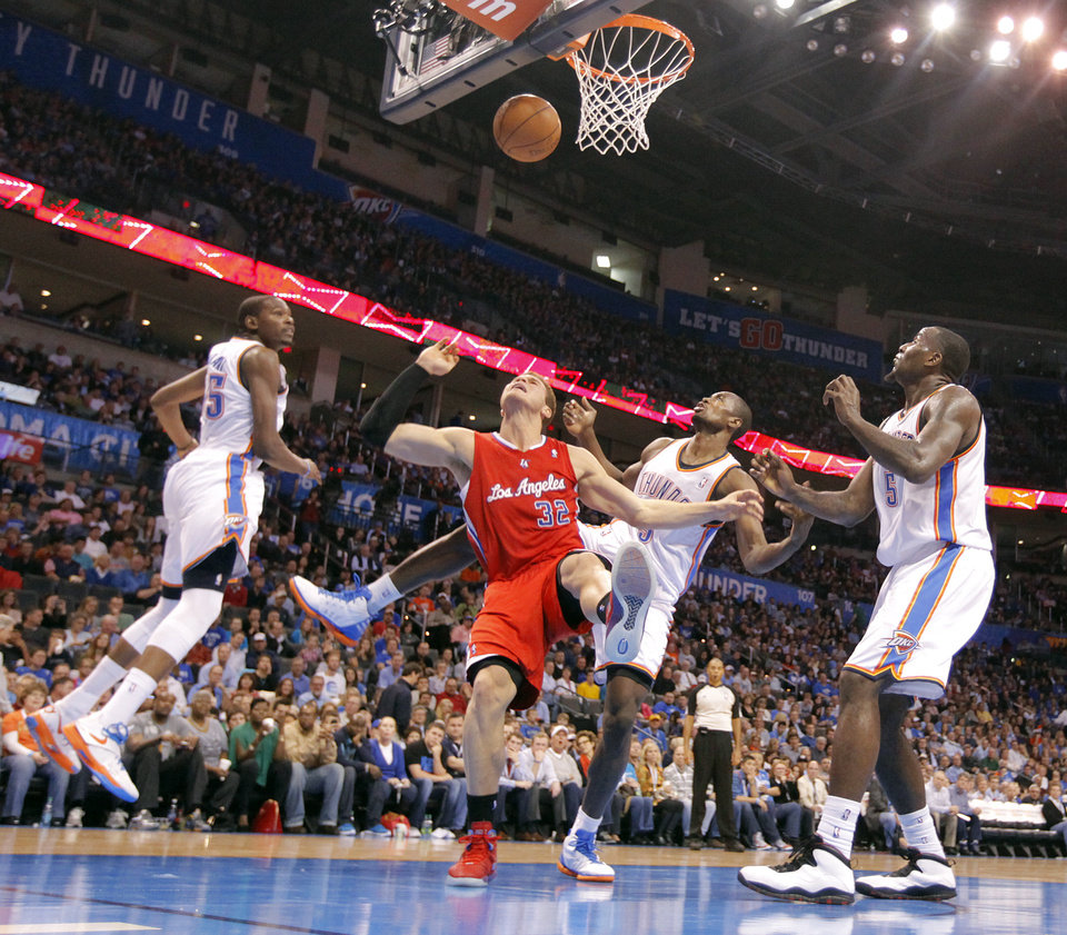 Photo - Los Angeles Clippers power forward Blake Griffin (32) battles under the basket with Oklahoma City Thunder small forward Kevin Durant (35), Oklahoma City Thunder power forward Serge Ibaka (9) and Oklahoma City Thunder center Kendrick Perkins (5) during the NBA basketball game between the Oklahoma City Thunder and the Los Angeles Clippers at Chesapeake Energy Arena on Wednesday, March 21, 2012 in Oklahoma City, Okla.  Photo by Chris Landsberger, The Oklahoman