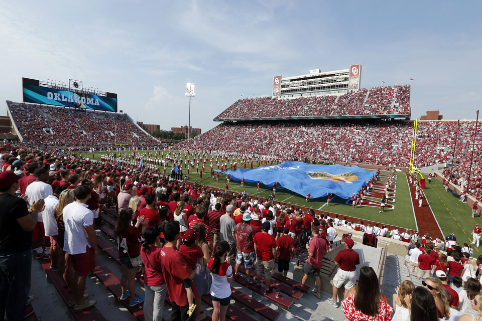 The band and Oklahoma Flag are on the field during the pre game of a college football game between the University of Oklahoma Sooners (OU) and the Tulsa Golden Hurricane (TU) at Gaylord Family-Oklahoma Memorial Stadium in Norman, Okla., on Saturday, Sept. 14, 2013. Photo by Steve Sisney, The Oklahoman
