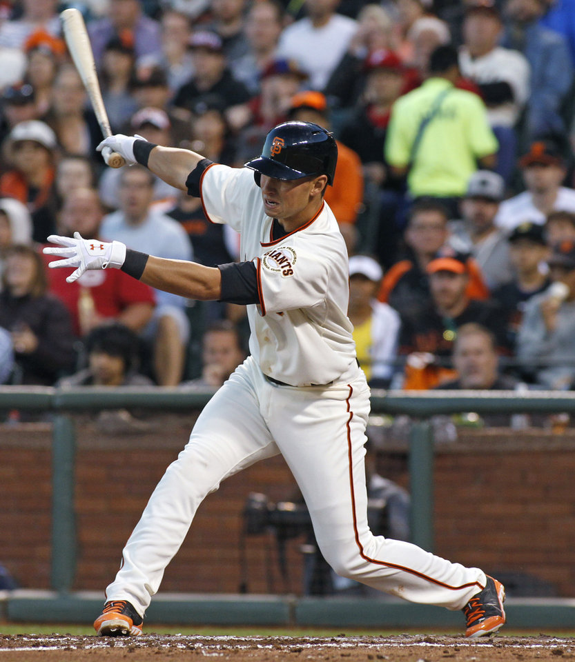 Photo - San Francisco Giants' Joe Panik hits a ground ball that scored Brandon Crawford against the Cincinnati Reds during the fifth inning of a baseball game, Saturday, June 28, 2014, in San Francisco. Panik was out at first. (AP Photo/George Nikitin)