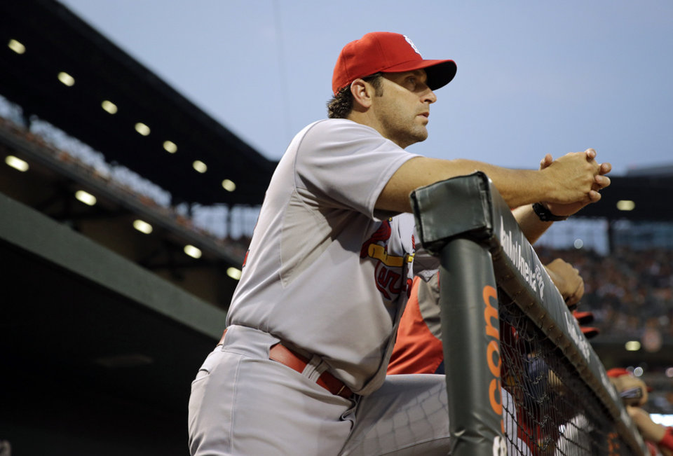 Photo - St. Louis Cardinals manager Mike Matheny watches from the dugout in the third inning of an interleague baseball game against the Baltimore Orioles, Friday, Aug. 8, 2014, in Baltimore. Baltimore won 12-2. (AP Photo/Patrick Semansky)