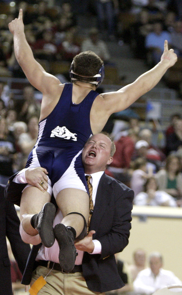Photo - Altus' Sean Carson celebrates his win over  Noble's Hunter Long in the 195-pound match with coach Nick Williams during the state wrestling championships at the State Fair Arena in Oklahoma City, Saturday, Feb. 25, 2012. Photo by Sarah Phipps, The Oklahoman