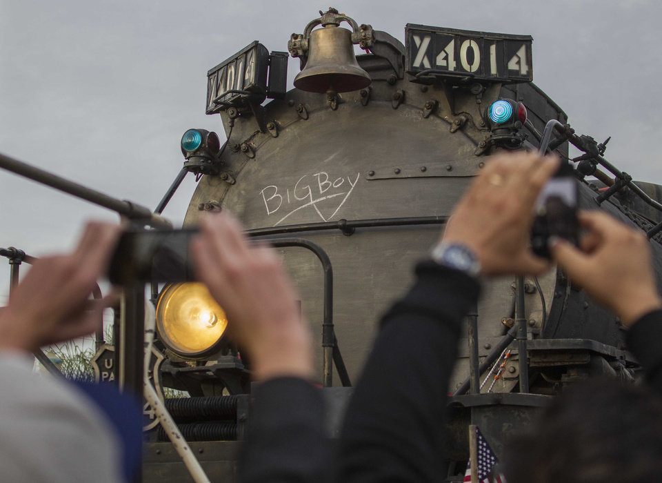 Photo - File - In this Jan. 26, 2014 file photo, spectators take pictures the historic locomotive, Union Pacific Big Boy No. 4014 at Metrolink Station in Covina, Calif., on Sunday, Jan., 26, 2014. Workers wrote