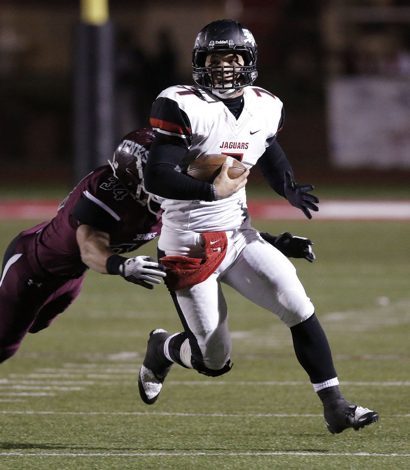 Photo - Westmoore quarterback Bryson Lee is caught from behind by Jenks (34) Luke Thompson during the 6A high school playoff game between Westmoore and Jenks at Yukon High School Friday November 29, 2013. Photo by Doug Hoke, The Oklahoman
