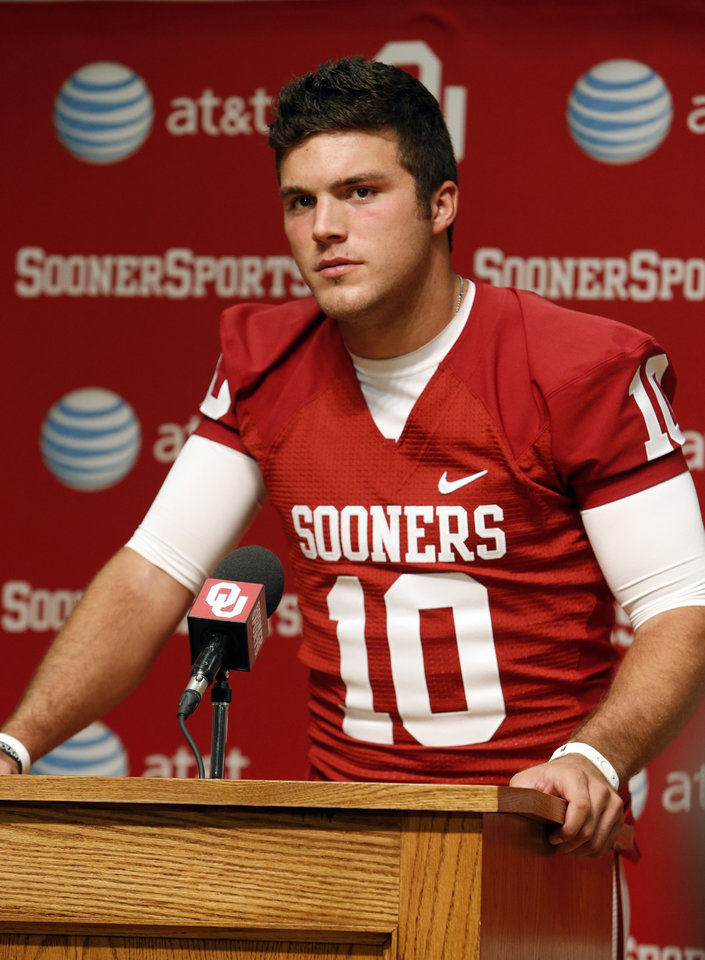 Photo - Quarterback Blake Bell speaks during media access day for the University of Oklahoma Sooner (OU) football team in the Adrian Peterson meeting room in Gaylord Family-Oklahoma Memorial Stadium in Norman, Okla., on Saturday, Aug. 3, 2013. Photo by Steve Sisney, The Oklahoman
