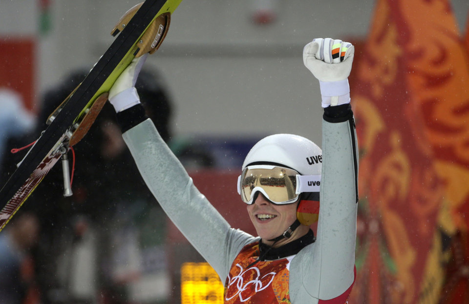 Photo - Germany's Eric Frenzel celebrates after his attempt during the Nordic combined individual Gundersen large hill competition at the 2014 Winter Olympics, Tuesday, Feb. 18, 2014, in Krasnaya Polyana, Russia. (AP Photo/Gregorio Borgia)
