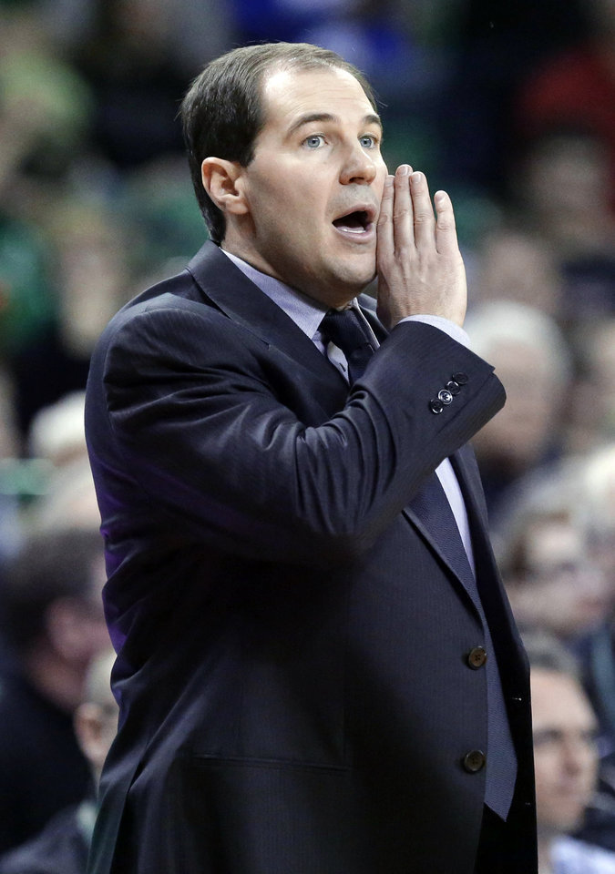 Photo - Baylor head coach Scott Drew gives directions from the sidelines during the first half of an NCAA college basketball game against Oklahoma Saturday, Jan. 18, 2014, in Waco, Texas. (AP Photo/LM Otero)