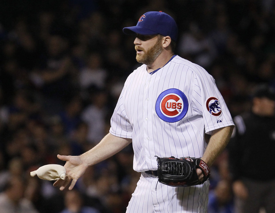 Photo -   Chicago Cubs starting pitcher Ryan Dempster goes to the rosin bag during the sixth inning of a baseball game against the Atlanta Braves Tuesday, May 8, 2012, in Chicago. (AP Photo/Charles Rex Arbogast)