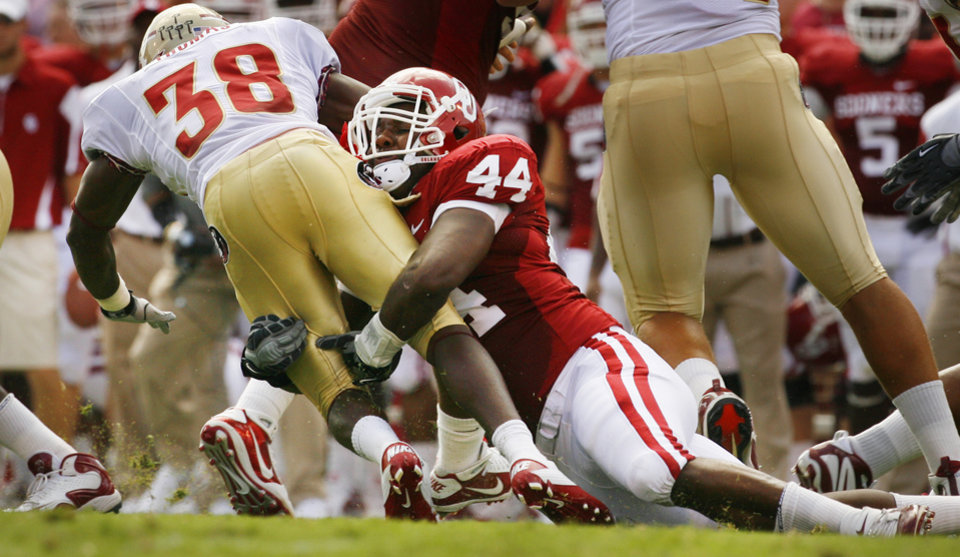 Photo - Jeremy Beal (44) tackles Jermaine Thomas (38) during the first half of the college football game between the University of Oklahoma Sooners (OU) and Florida State University Seminoles (FSU) at the Gaylord Family-Oklahoma Memorial Stadium on Saturday, Sept. 11 2010, in Norman, Okla.   Photo by Steve Sisney, The Oklahoman