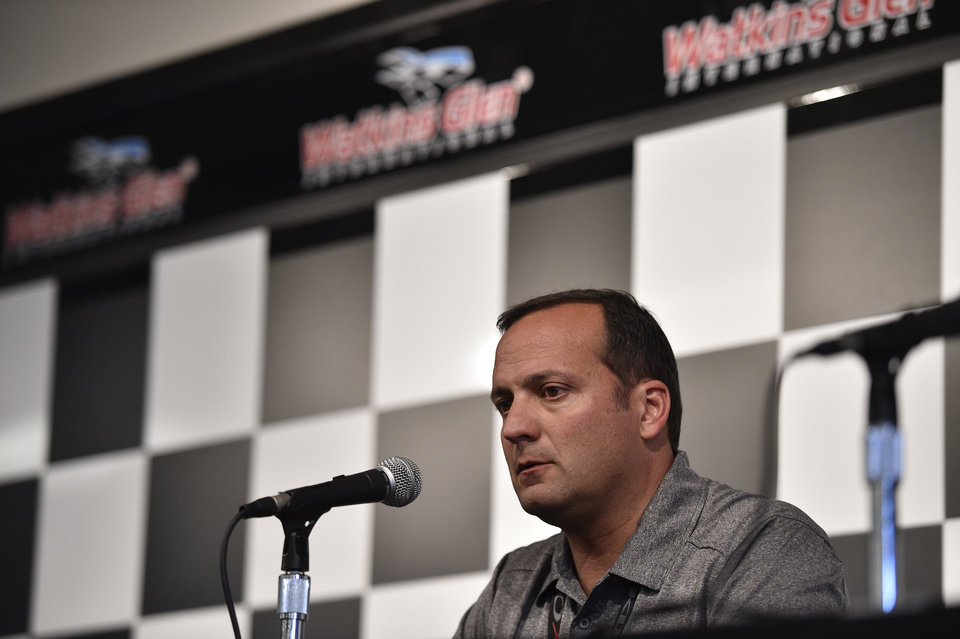 Photo - Greg Zipadelli, competition director of Stewart-Haas Racing, addresses members of the media before a NASCAR Sprint Cup Series auto race at Watkins Glen International, Sunday, Aug. 10, 2014, in Watkins Glen N.Y. Zipadelli said Tony Stewart would not drive Sunday after he struck and killed a sprint car driver who had climbed from his car and was on the track trying to confront Stewart during a race in upstate New York on Saturday night. (AP Photo/Derik Hamilton)