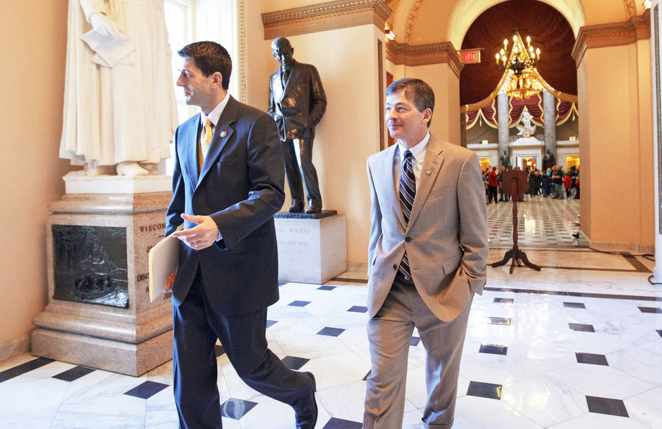 Photo - House Budget Committee Chairman Rep. Paul Ryan, R-Wis., left, and Rep. Jeb Hensarling, R-Texas walk to the House floor Friday on Capitol Hill in Washington, for the final vote on the payroll tax cut extension. AP Photo