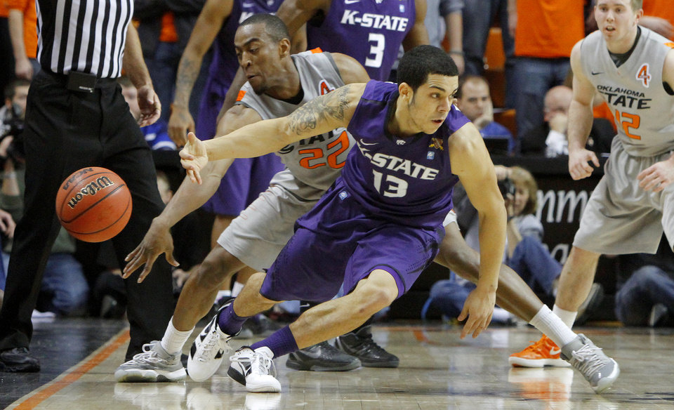Photo - Oklahoma State's Markel Brown (22) knocks the ball away from Kansas State's Angel Rodriguez (13) during an NCAA college basketball game between the Oklahoma State University Cowboys (OSU) and the Kansas State University Wildcats (KSU) at Gallagher-Iba Arena in Stillwater, Okla., Saturday, Jan. 21, 2012. Photo by Bryan Terry, The Oklahoman